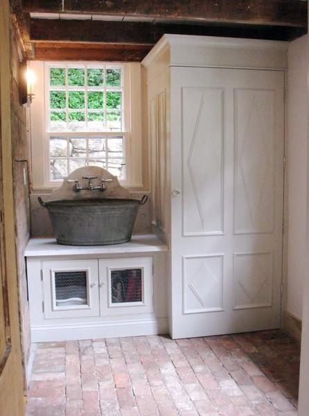 wash tub sink, washer and dryer behind cabinet, chicken wire on doors ...