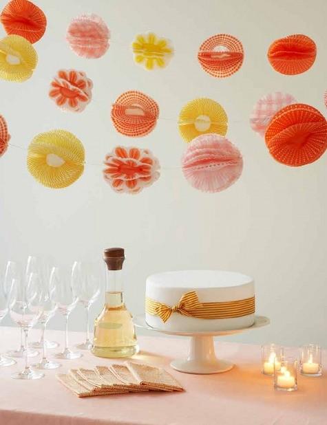 DIY Cupcake Liner Pom Poms from Handmade Weddings by Eunice and Sabrina Moyle and Shana Faust via Design Sponge. #Pom_Poms #Handmade_Weddings