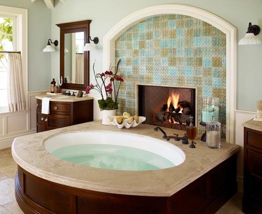 Tiled Fireplace Next To A Nice Big Spa Bath