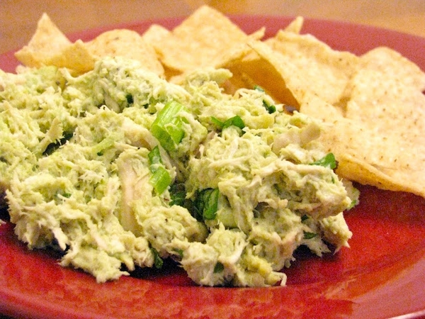 chicken salad made by mixing avocado, cilantro, salt, and lime juice ...