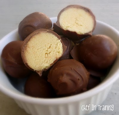 Dipping Cake Balls In Melted Chocolate