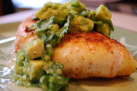 Seared chicken with lime avocado topping