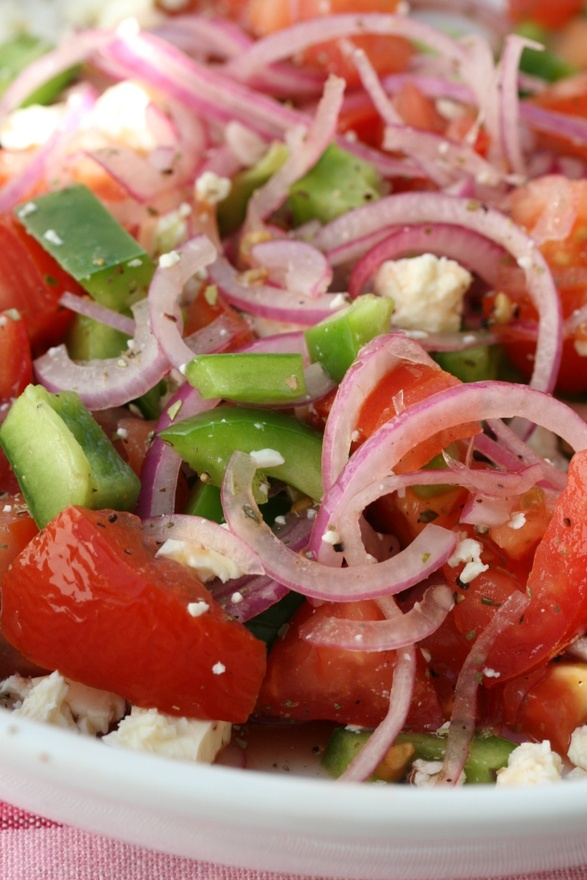 simple salad of red onions, tomatoes, green pepper and feta