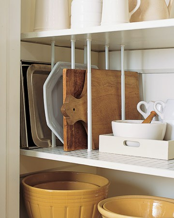 Use tension curtain rods as dividers for cupboard shelves. Great idea for cutting boards and serving plates. — Genius Idea!