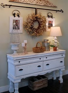 love the idea of using curtain rod to hang wreath! Great combination with the pics and other decorations